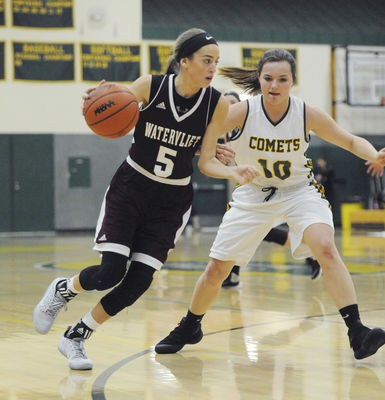 Coloma player defends Watervliet player in game earlier this year.