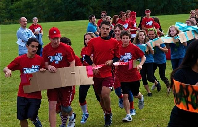 students in cardboard car race