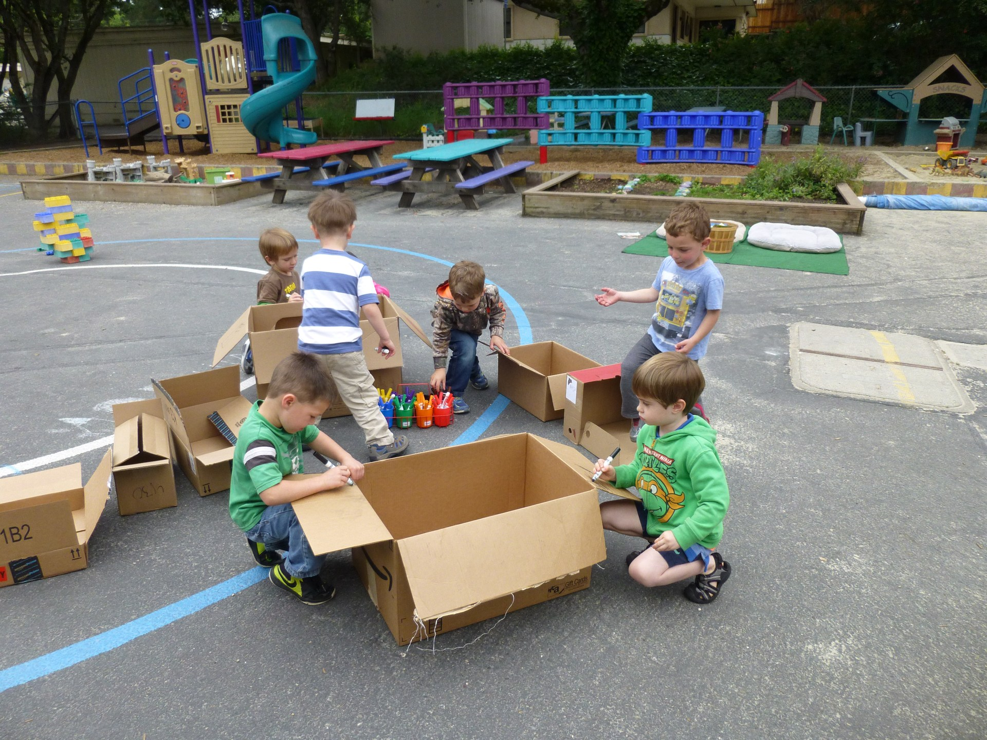 Students playing with boxes