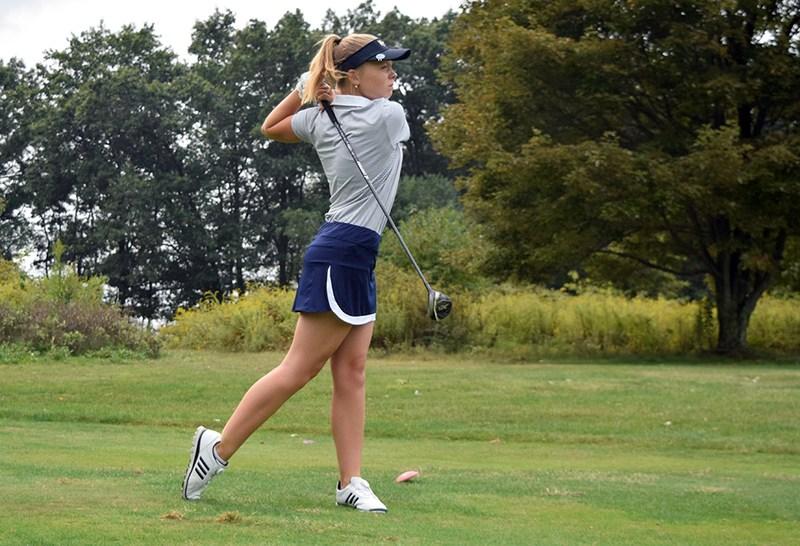 Girl swinging a golf club