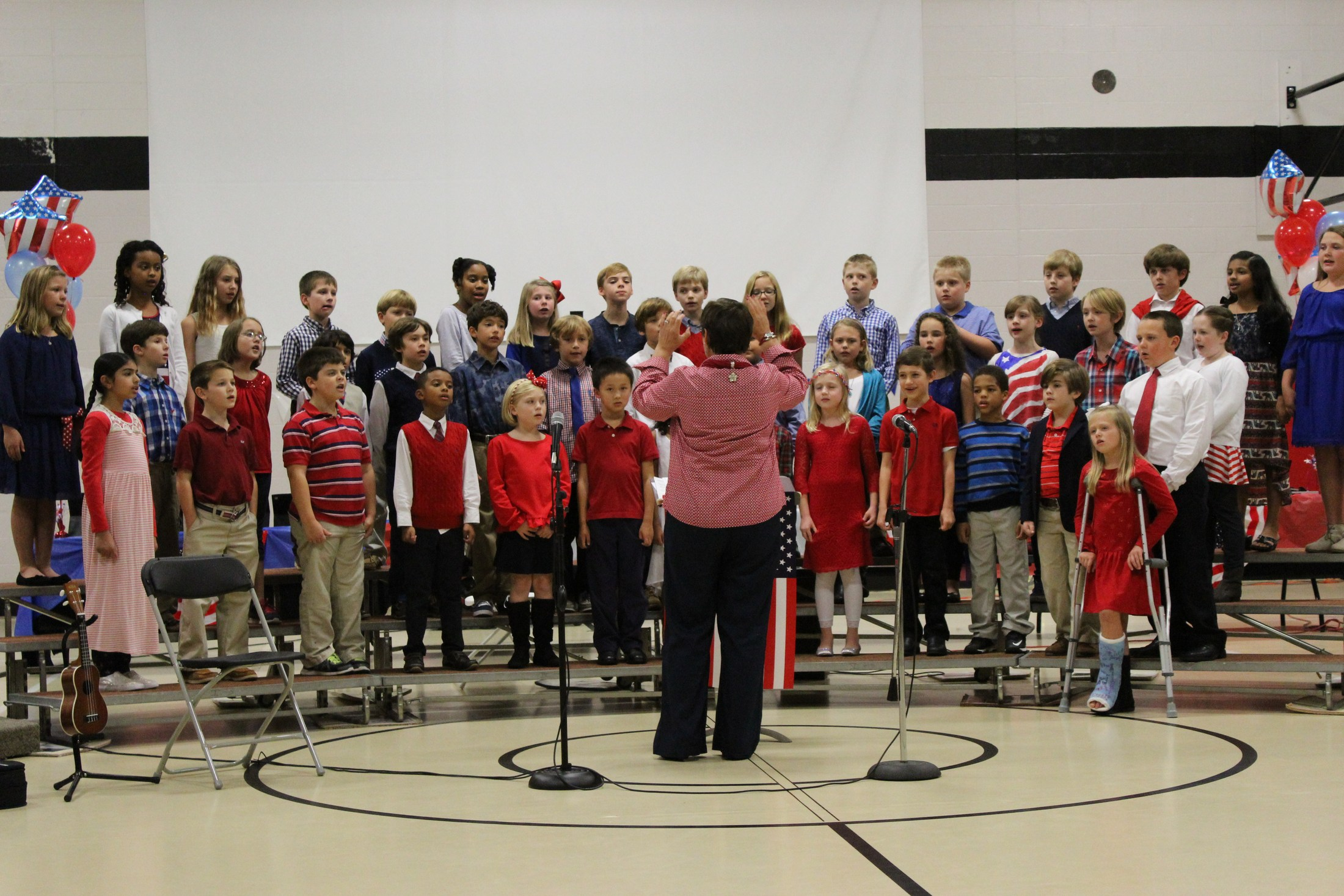 lower school performing at veterans' day concert
