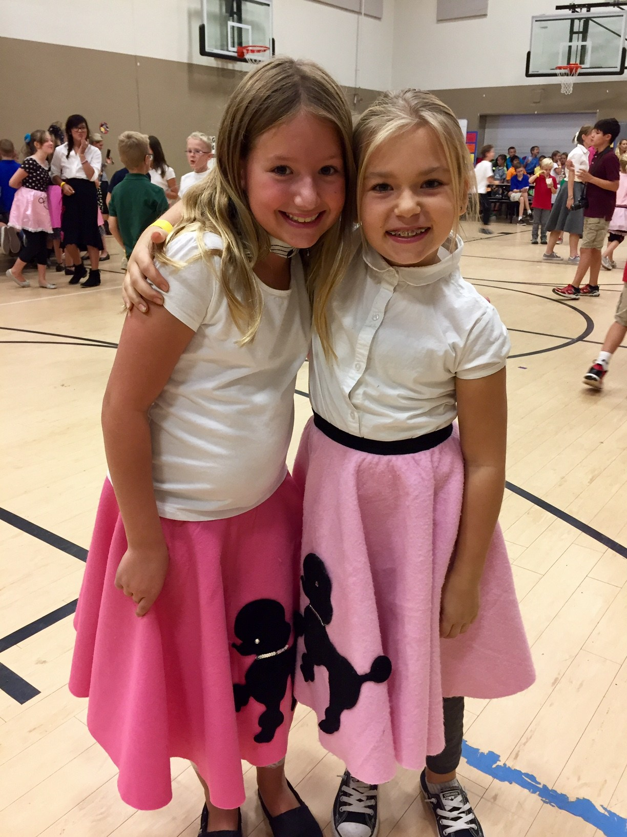 two girls in sock hop outfits