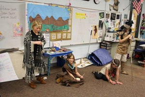 A student presents on Native American culture at night at the museum.