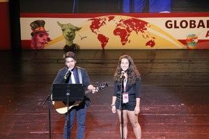 Photo of 2018 World Scholar's Cup Student singing in the Athens Talent Show