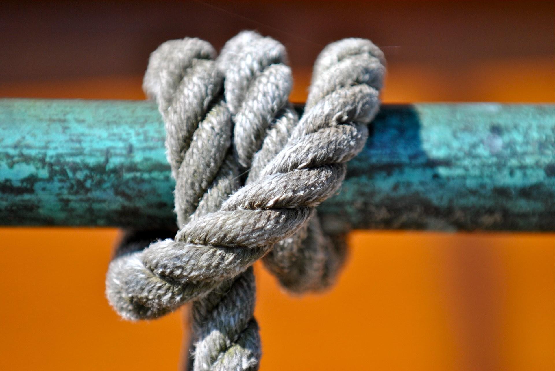 Rope on copper railing, Poulsbo, WA.