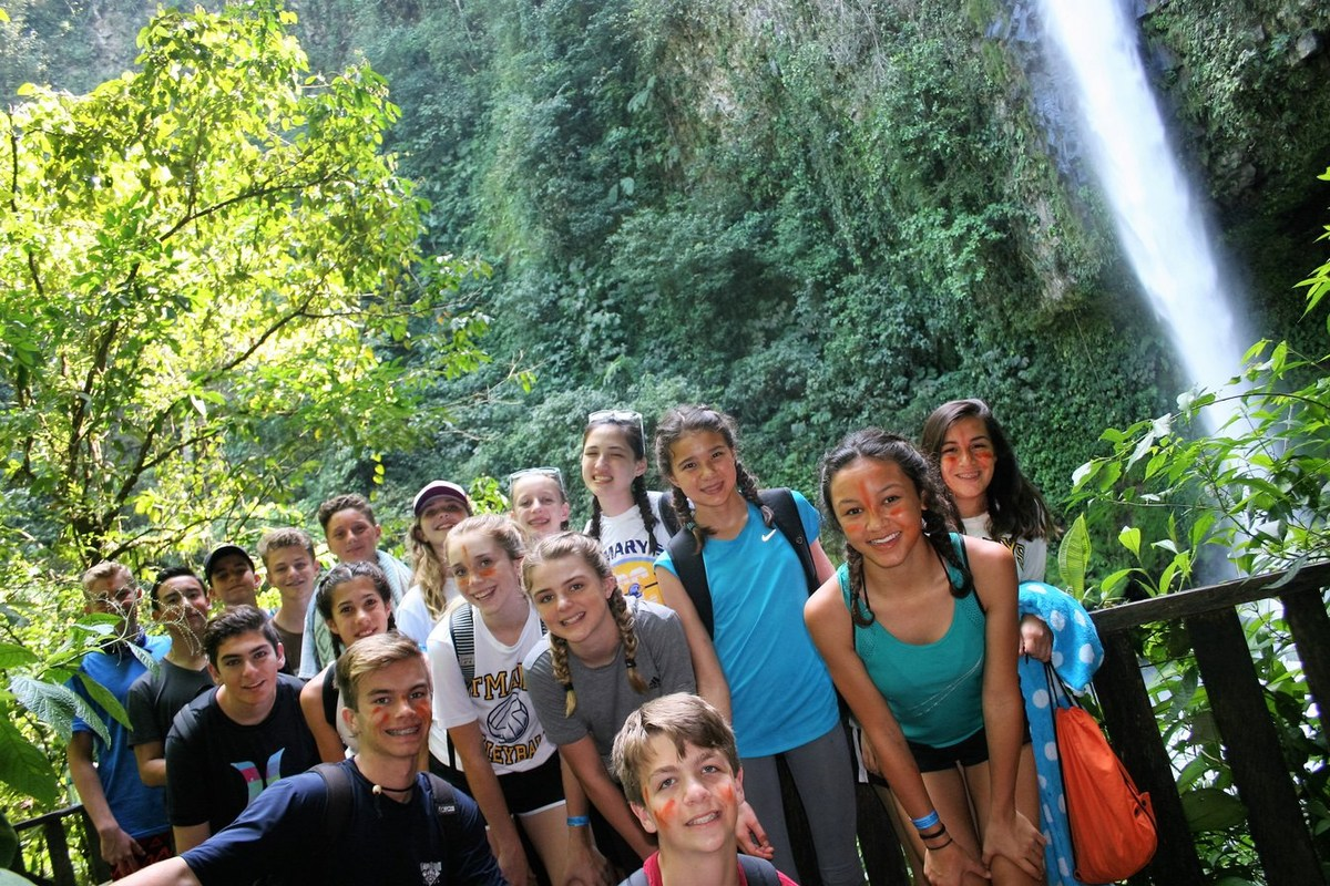group photo near water falls in Costa Rica