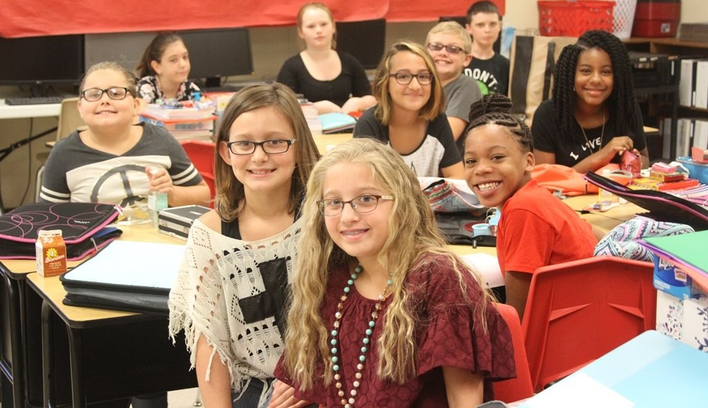 Intermediate students facing the camera with smiles
