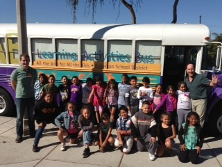 Students and teachers in front of the Arts LAB Bus.