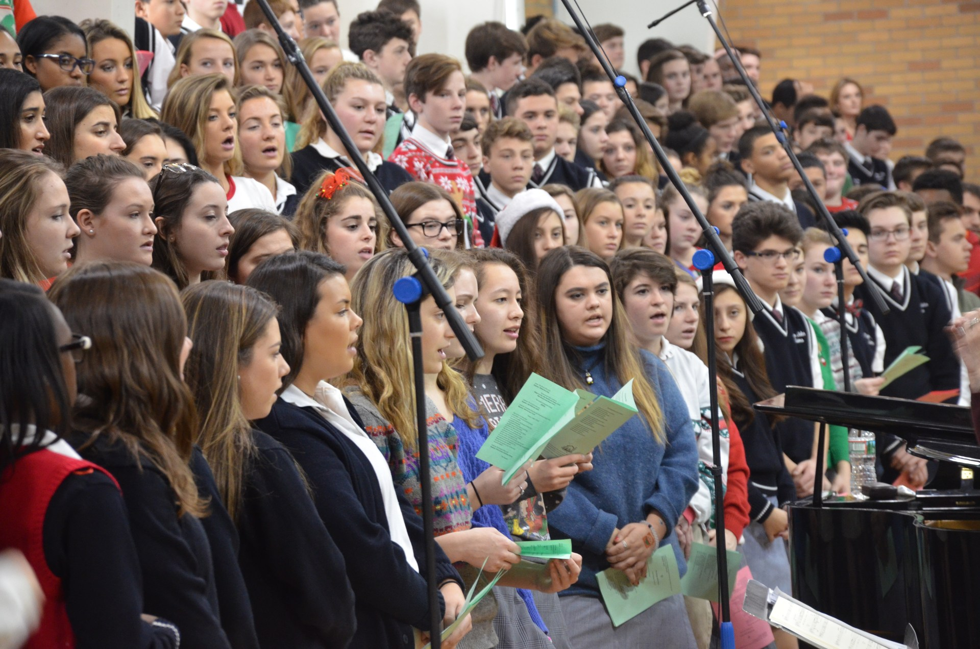 Students singing second Christmas song at mass