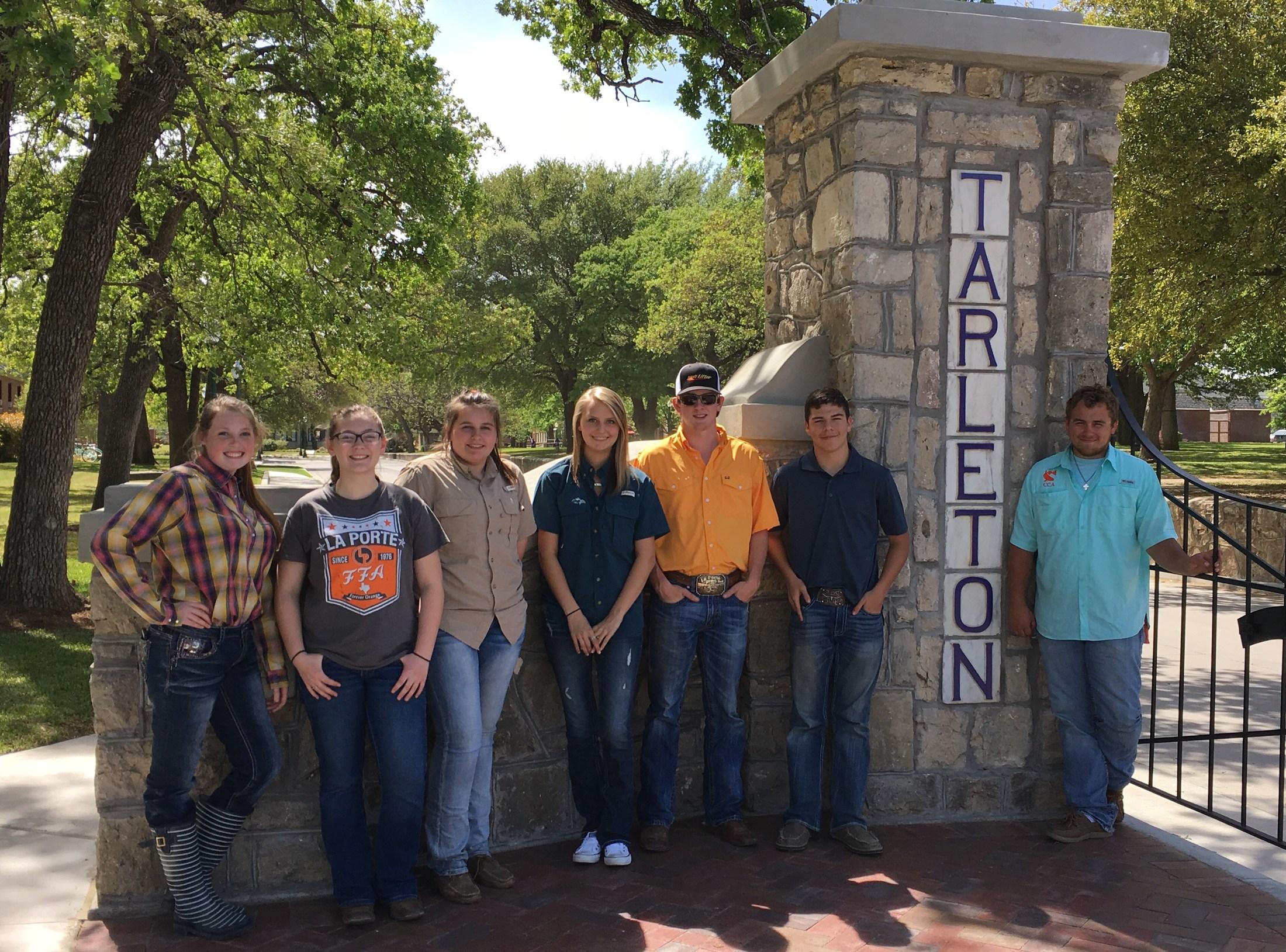 Ag students posing near Tarleton State University pillar