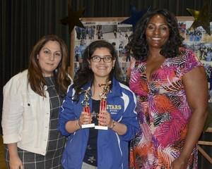 Vivian getting her award from Kym Hampton