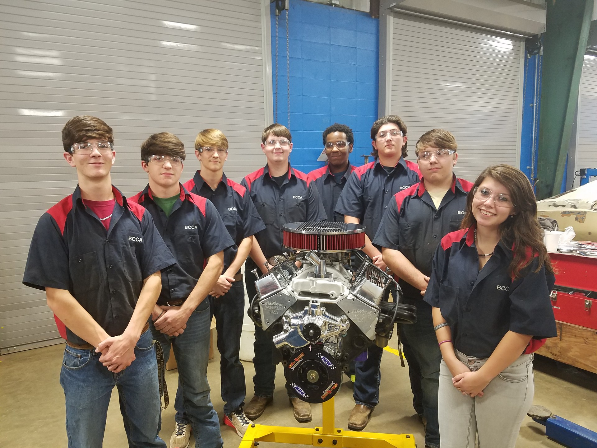 Auto students with Hot Rodders engine.