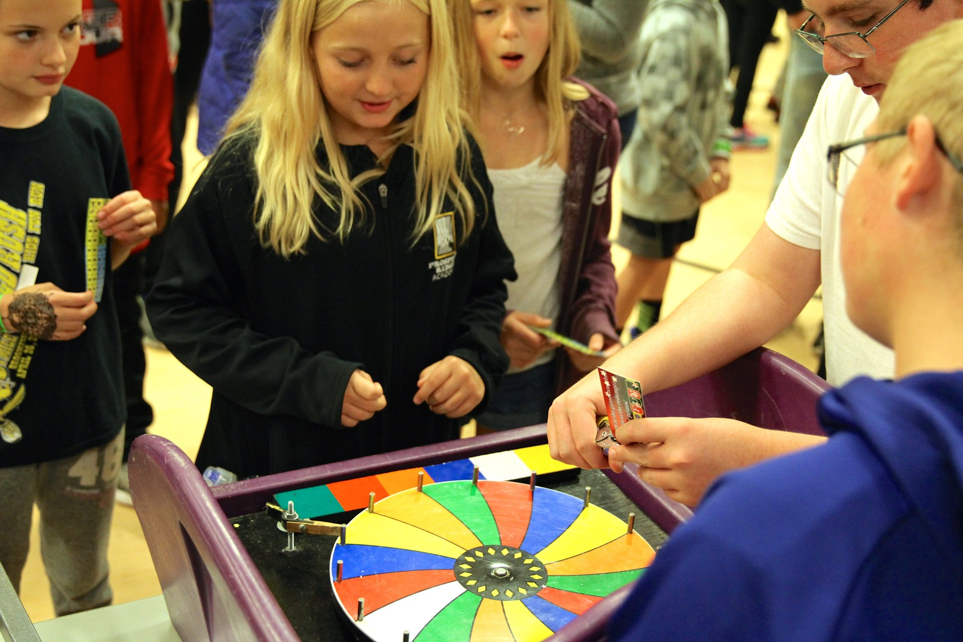 student playing a carnival game