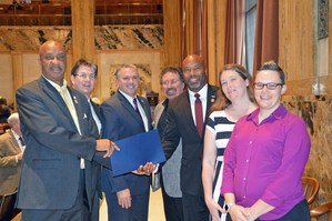 Representatives congratulate superintendent and teachers