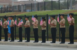 Cadets holding American Flags during the Police Processional