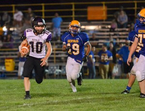 Aidan Perry #10 playing football with PCS team