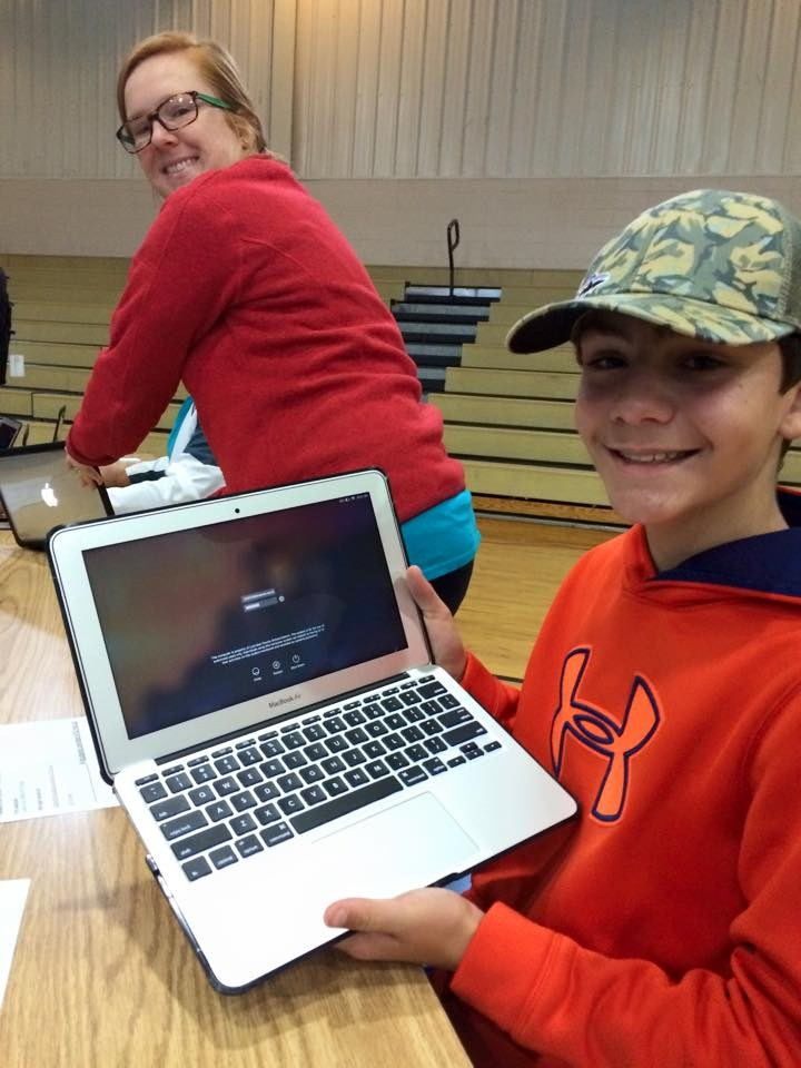 Student enjoying his new MacBooks in the rollout