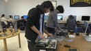 Students working on assembling computer parts.=