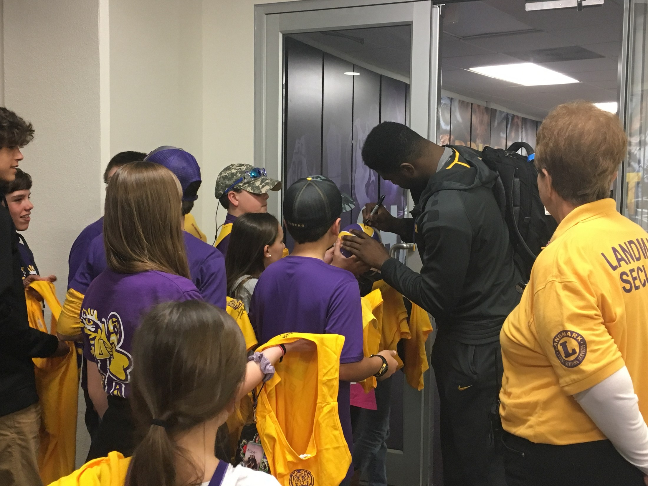 LSU Basketball player signing shirts, posters, etc.