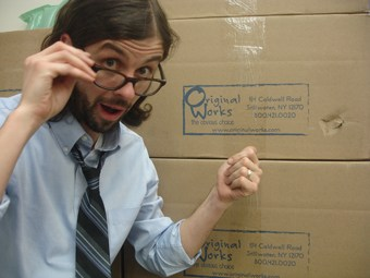 Mr. See (the K5 art teacher) pointing at a box full of Original Works Orders from the art department!