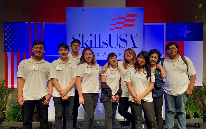group picture of the multimedia students on the SkillsUSA stage.