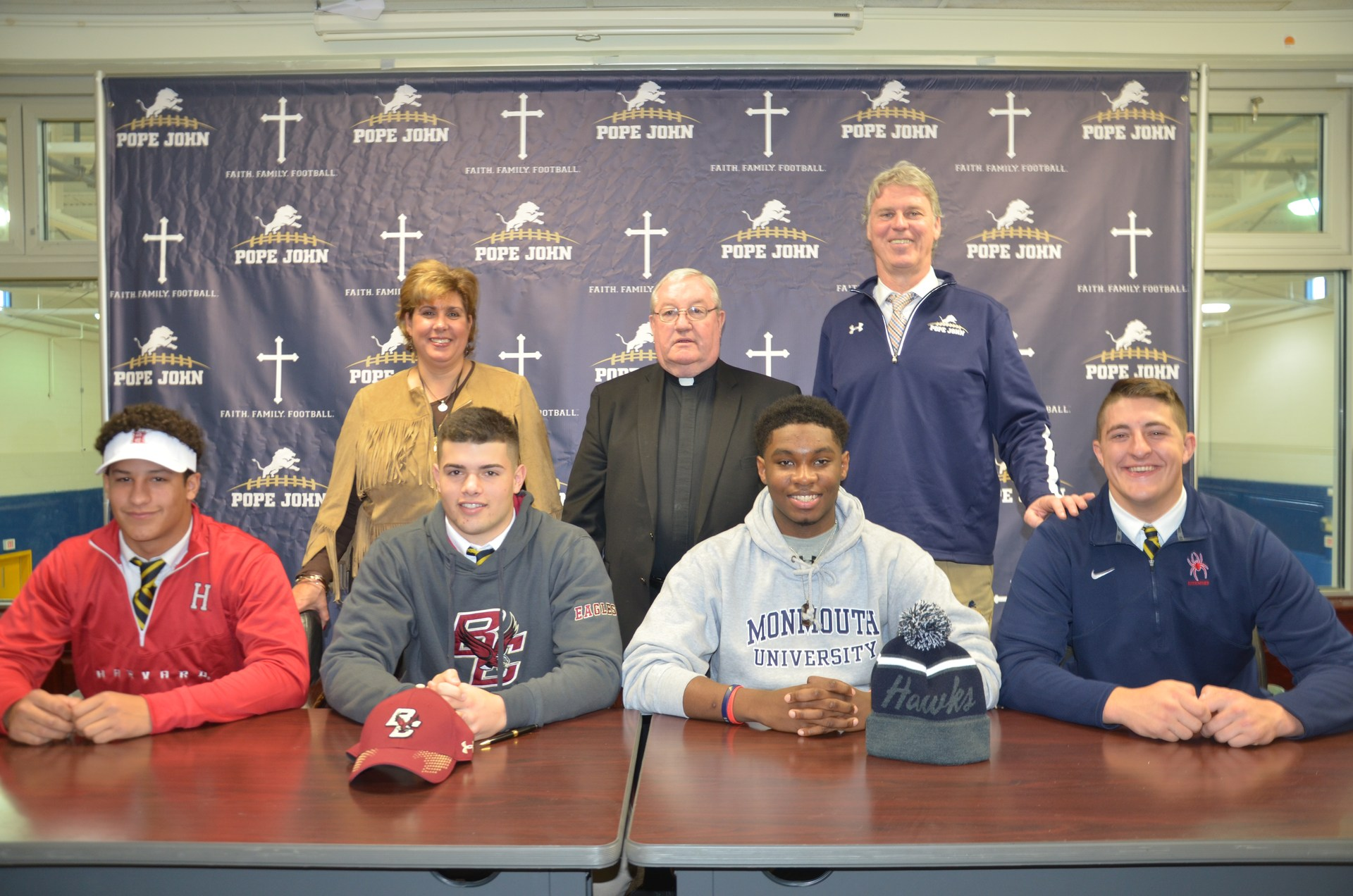 Football players signing National Letters of Intent
