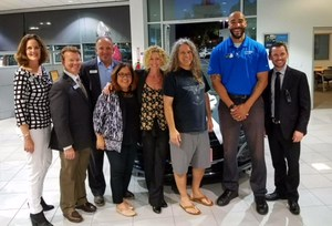 Bowman Teacher Michael Coombe (third from right) stands with managers from AutoNation Chevrolet Valencia and WiSH Education Foundation board members