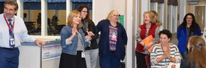 EVE Principal, Colleen Crowston, sharing a fun story with her staff after the announcement.