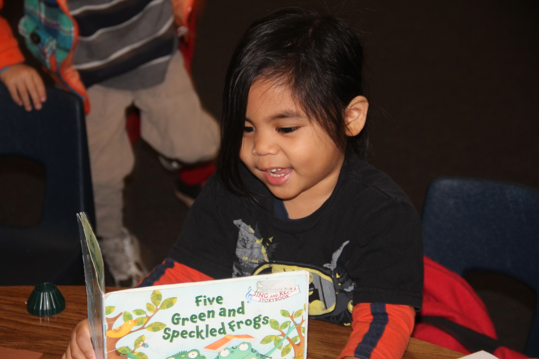 TK student reading a book