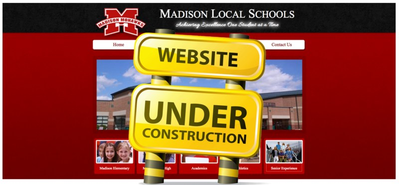 Screenshot of website with construction sign