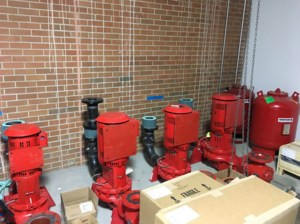 Red pumps are set in the North mechanical room.