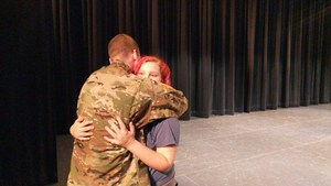 Hunter Davis and sister Taegan Rodriguez hug on stage.
