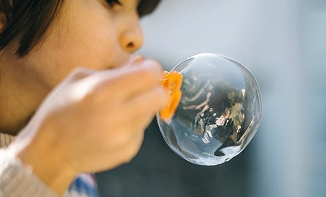 kid blowing bubble
