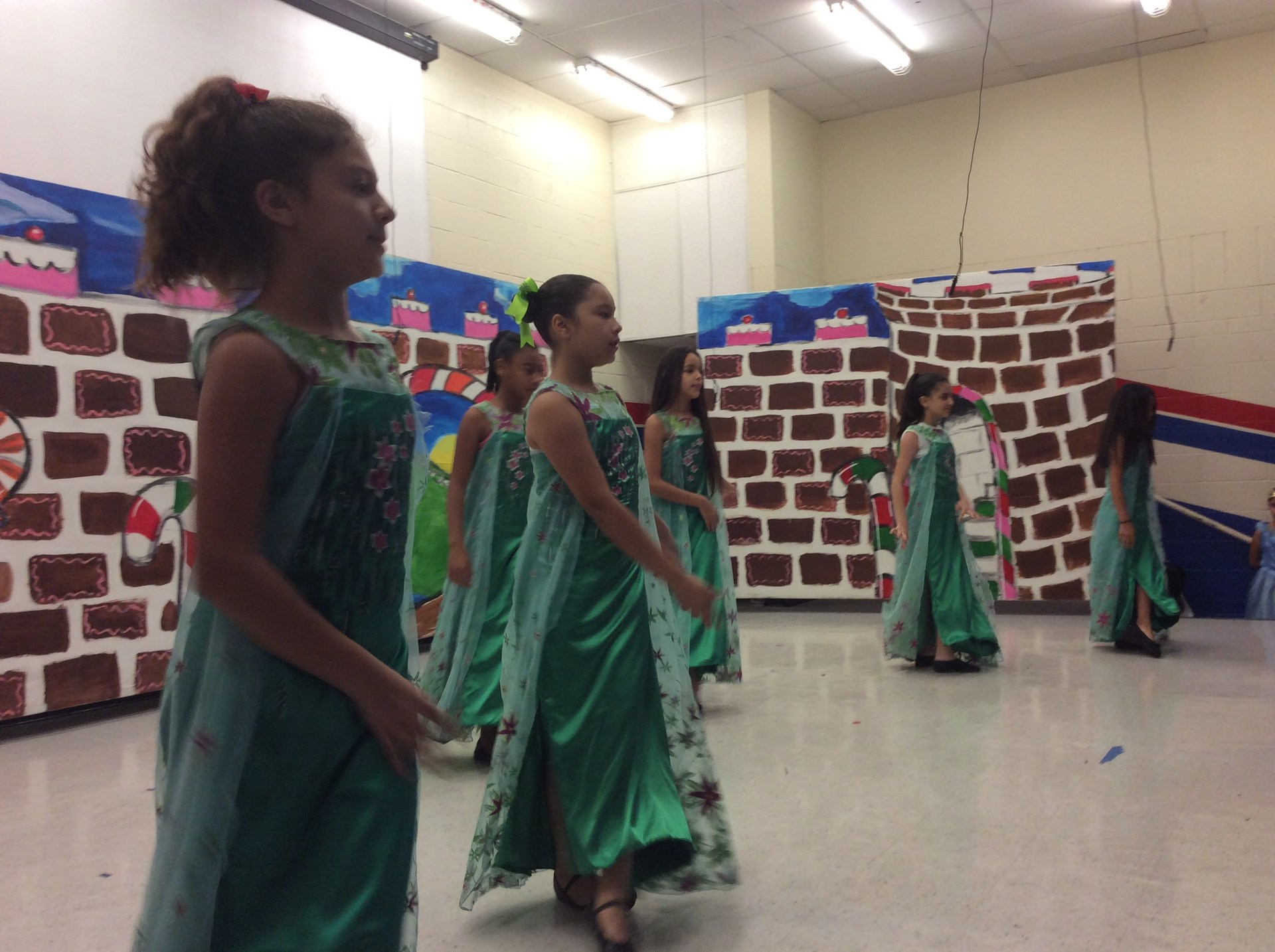 Girls dancing on stage for Nutcracker.