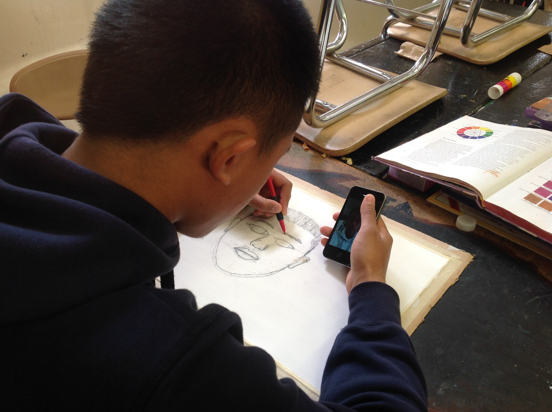Student drawing portrait