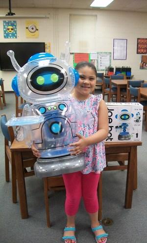Briana Gomez with robot prize she won.