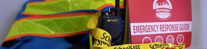 Image of school safety elements, including a radio, an SRP book etc.