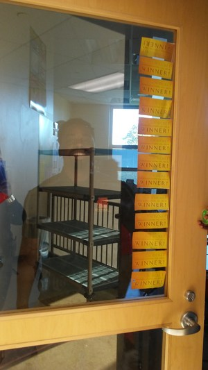 Mr Yeargin's class door decorated with winning stickers for class walking correctly in the halls