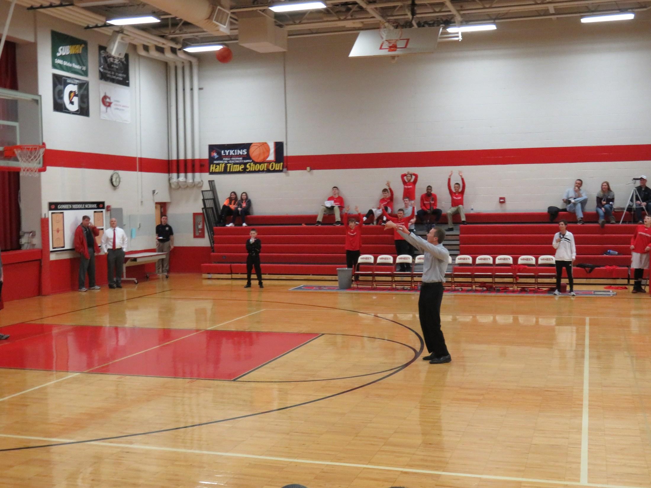Parent shooting Lykins Energy halftime shot