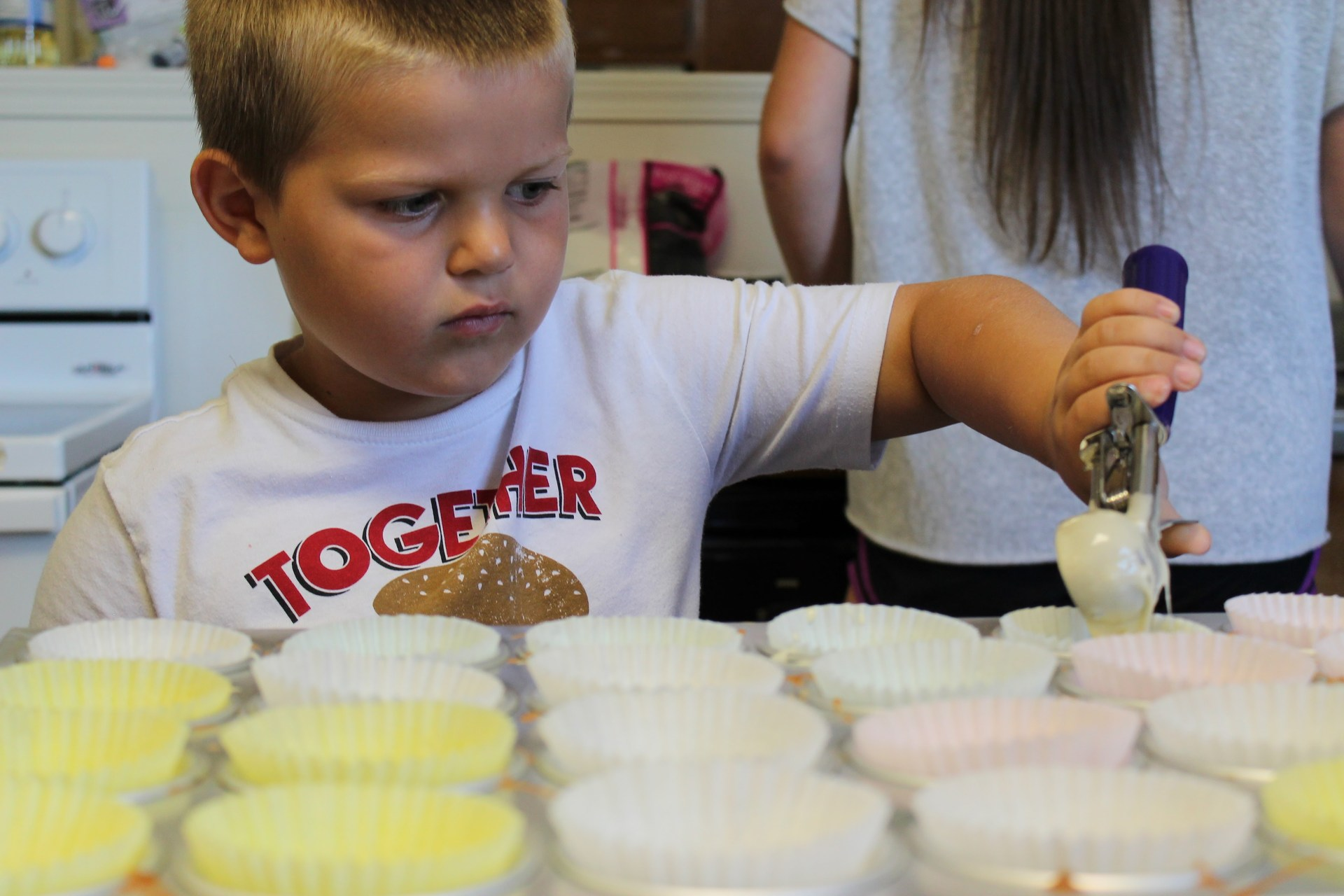 Child making cupcakes