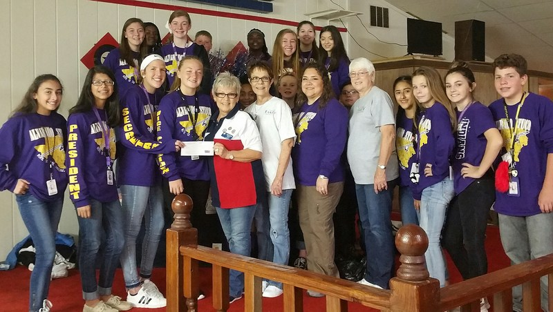 Junior High students accepting a donation from the American Legion.