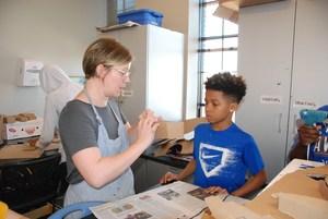 Art teacher with student, Grand Center Arts Academy 2017