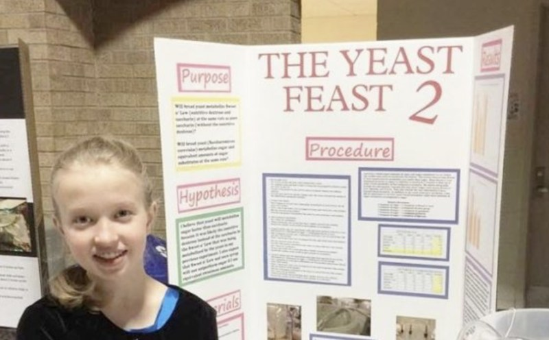 Student with science fair project