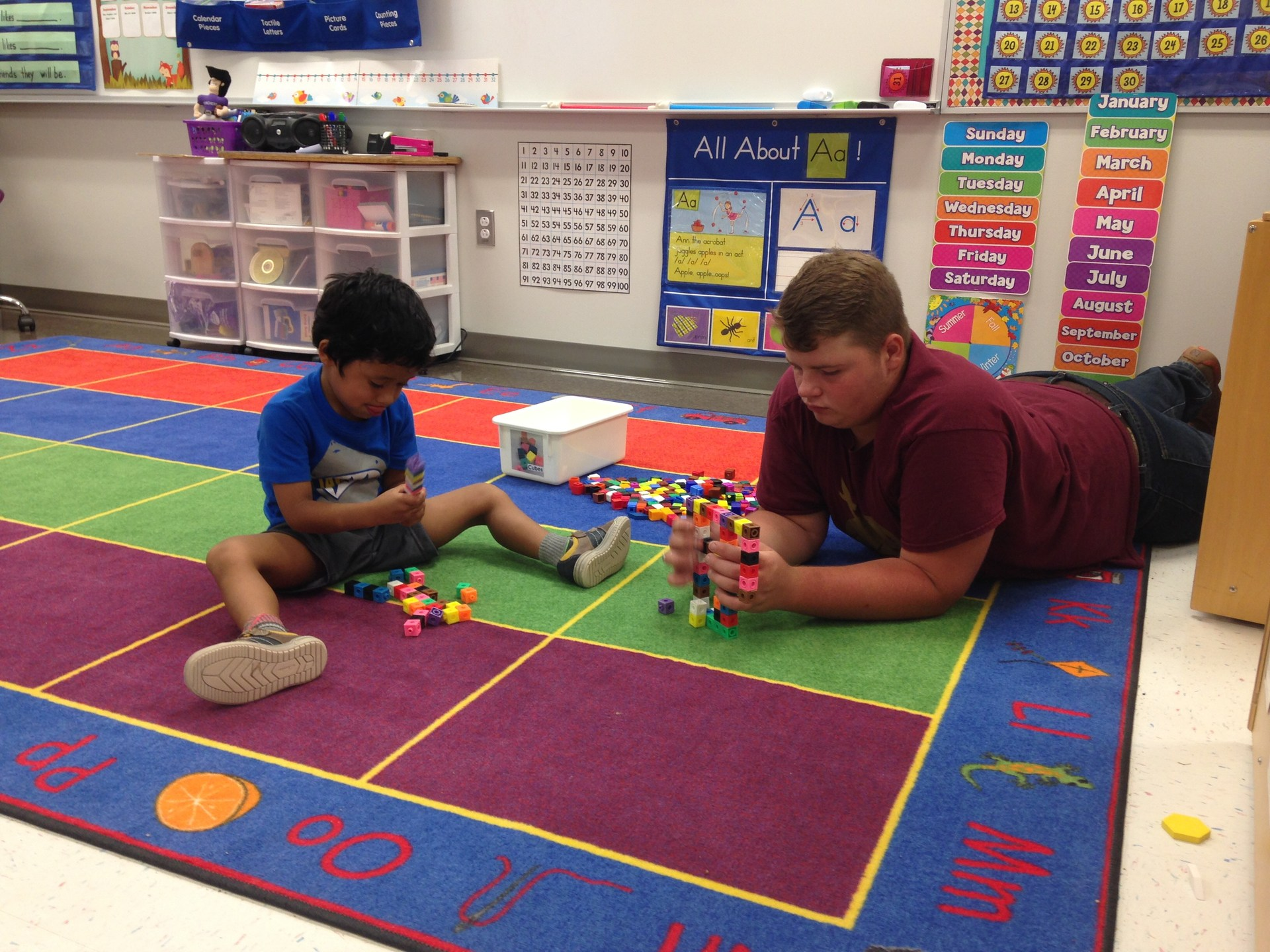 Senior Jimmie Airheart helps in Kinder