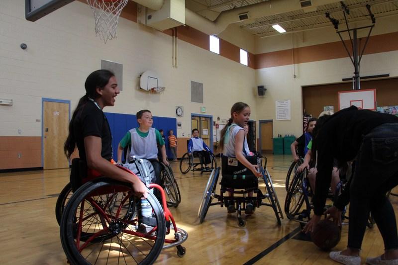 Students at Florida Mesa Elementary play wheelchair basketball.
