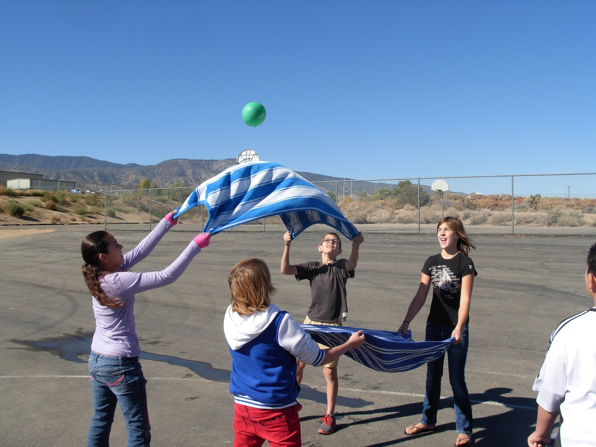 Students doing a water balloon toss.