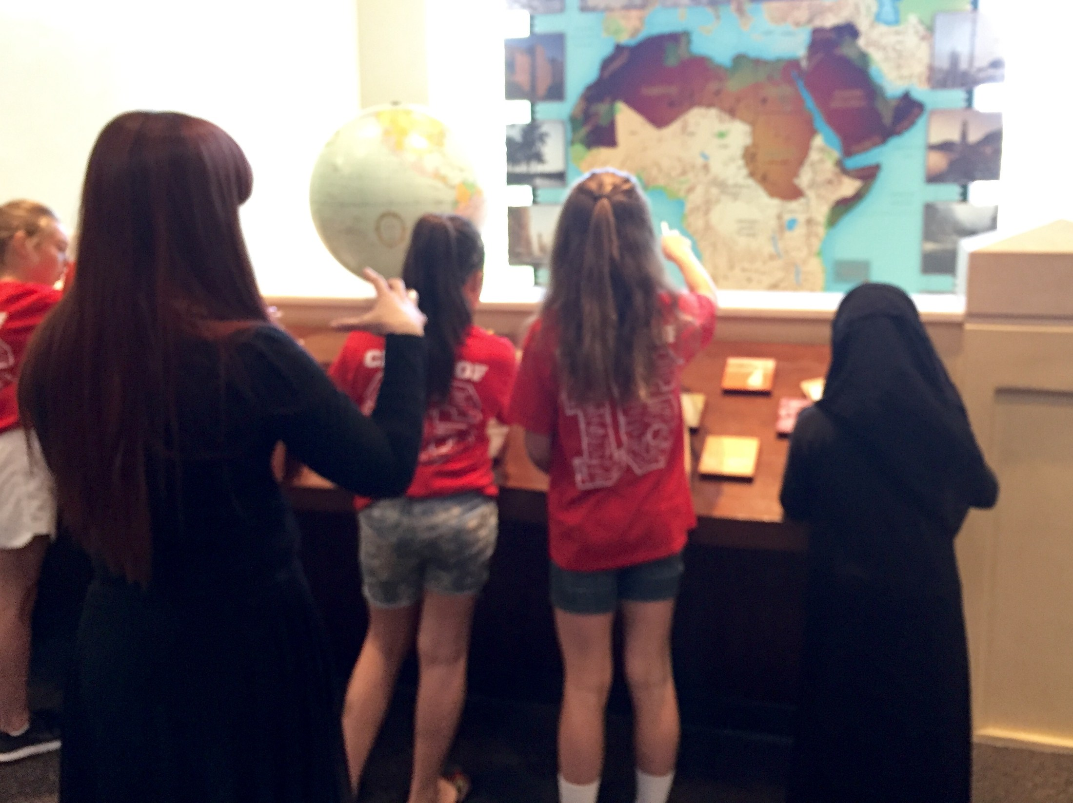 Students doing a scavenger hunt at the Arab American Museum in East Dearborn with Holbrook School.