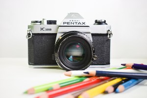 Picture of camera with colored pencils