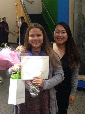 Ms. Mai stands with CCA's Global Learner Award recipient.