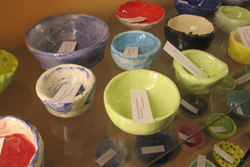 Ceramic bowls that were created for a fundraiser event.